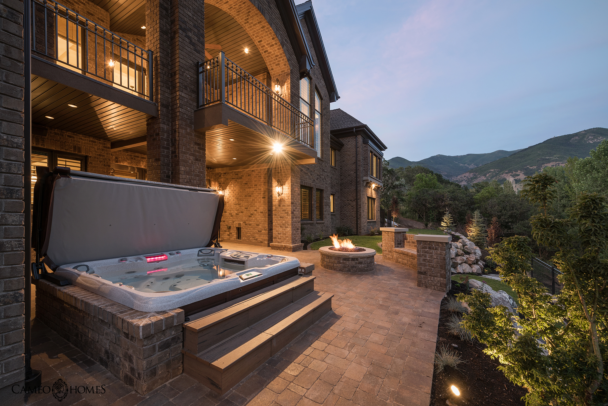 Hot tub outside beautiful mansion.