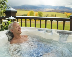 Man with arthritis soaking in the hot tub.