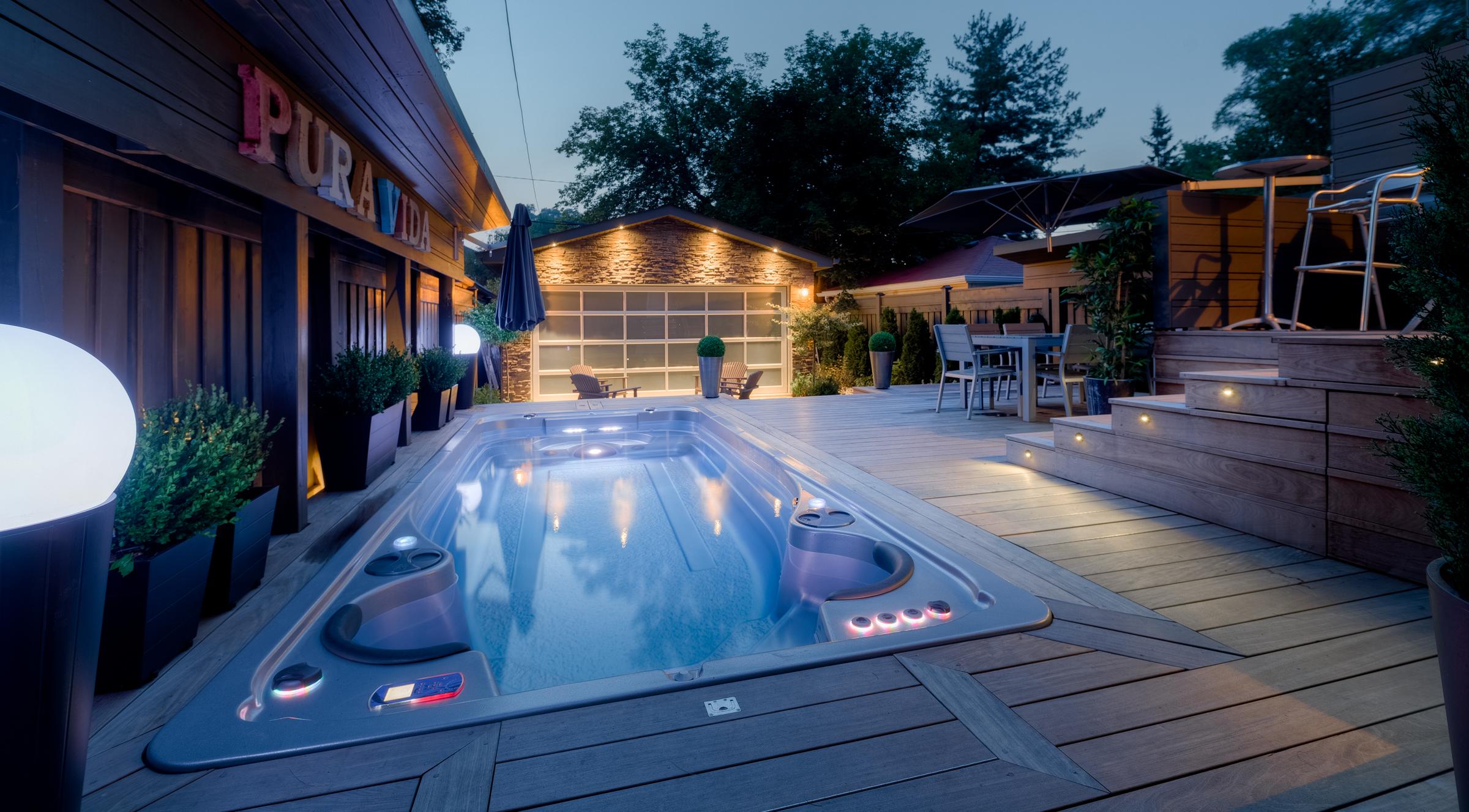 Outdoor swim spa installation at dusk.