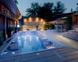 Outdoor swim spa installation at dusk.