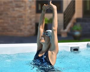 Woman stretching in a swim spa.